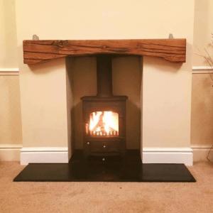 Arched oak mantel fire place beam