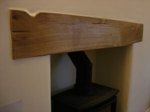 Reclaimed railway sleeper beam for a fire place